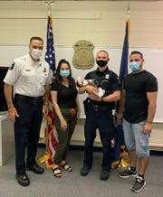 The family of the infant who was saved from choking by a Sterling Heights police officer stopped by to express their gratitude.