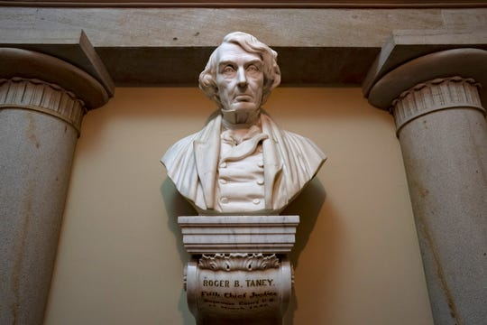 FILE - In this March 9, 2020 file photo, a marble bust of Chief Justice Roger Taney is displayed in the Old Supreme Court Chamber in the U.S. Capitol in Washington.