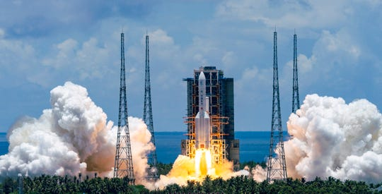 A Long March-5 rocket carrying the Tianwen-1 Mars probe lifts off from the Wenchang Space Launch Center in southern China's Hainan Province, Thursday, July 23, 2020.