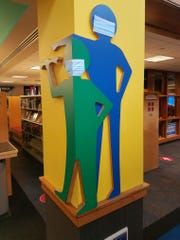 Even the decorations wear face masks at the West Bloomfield Township Main Library.