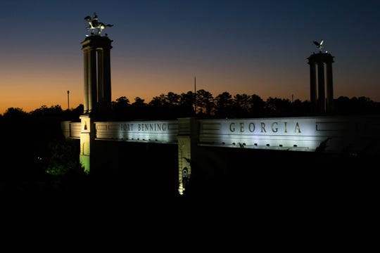 FILE - In this Oct. 16, 2015, file photo a bridge marks the entrance to the U.S. Army's Fort Benning as the sun rises in Columbus, Ga.