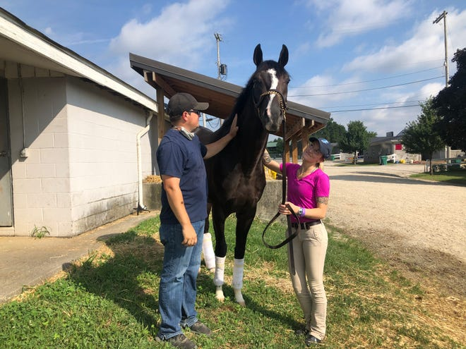 Jason Barkley and his girlfriend/assistant trainer/exercise rider Shelbi Kurtz with Olson, who won a three-horse photo in an Ellis Park allowance race this past Saturday.