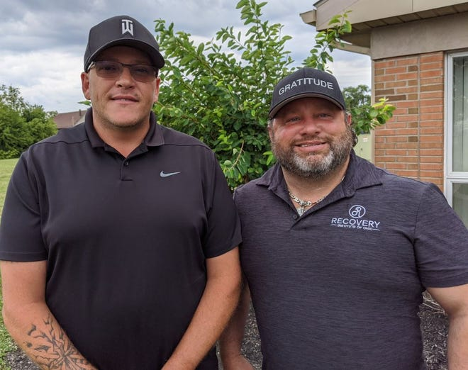 Recovery Institute of Ohio CEO and co-founder Nate Kehlmeier, left, with Kyle Overmyer, right.
