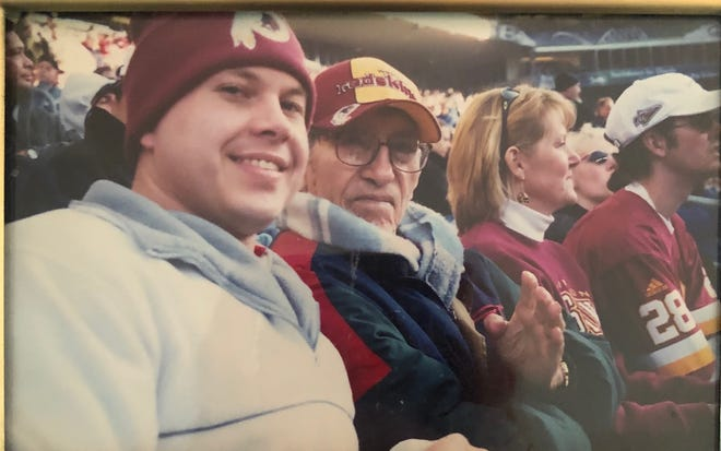 "Walter ""Blackie"" Wetzel (right) attends a Washington Football Team game with his son Lance."