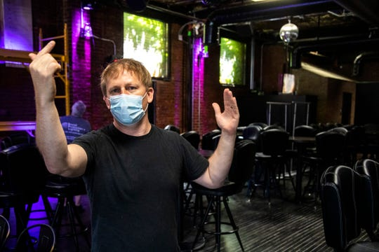 Owner Bob Franklin wears a mask while talking about renovations that took place prior to opening, Thursday, July 23, 2020, at Elray's Live & Dive in Iowa City, Iowa.