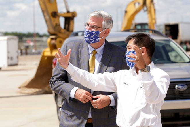 Gov. Eric Holcomb talks with Ryota Fukumizu, SIA president and COO, speak during a ground breaking for a $158 million expansion at Subaru of Indiana Automotive, Thursday, July 23, 2020 in Lafayette.