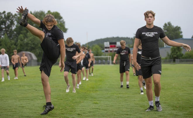 High school athletic trainers are required to follow strict Covid-19 guidelines as teams ramp up for the fall football season. Bullitt Central players warm up on the school's field at the start of practice. July 23, 2020
