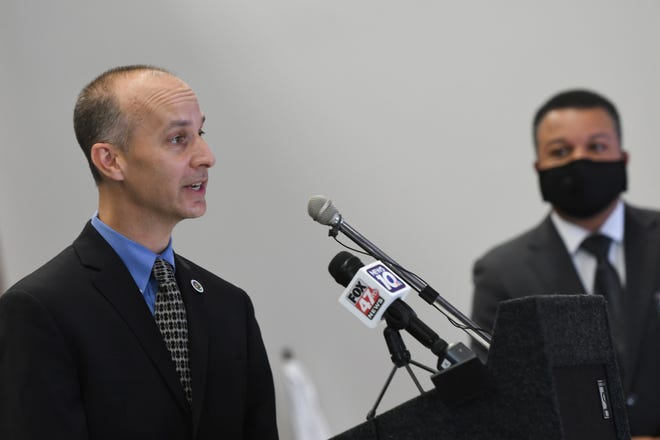 Lansing Mayor Andy Schor speaks Thursday, July 23, 2020, during a press conference at City Hall announce  the details of a Racial Justice & Equity Community Action Plan.  Also pictured is Police Chief Daryl Green.