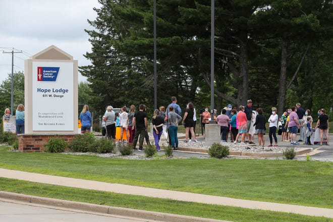 Protesters gather in the parking lot on Thursday, July 23, 2020, at the American Cancer Society Hope Lodge in Marshfield, Wis. Protesters were out to protest the ACS decision to close the facility. Tork Mason/USA TODAY NETWORK-Wisconsin