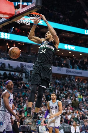 Giannis Antetokounmpo scored 22 points Thursday against the Spurs in the Bucks' first scrimmage in the NBA bubble.