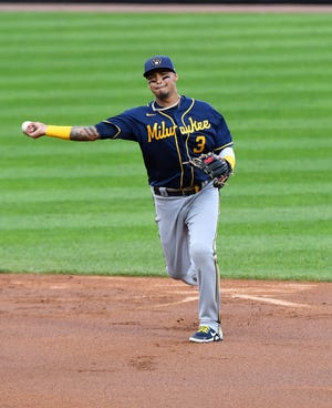 Brewers shortstop Orlando Arcia makes a throw to first base.