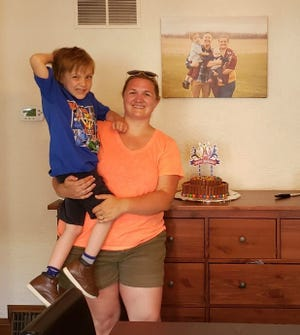 Melody Rensberger invited the community to celebrate her son Theo's birthday by bringing their dogs to their home.