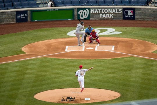 Washington Nationals starting pitcher Max Scherzer throws the first pitch to New York Yankees' Aaron Hicks at Nationals Park during an opening day baseball game, Thursday, July 23, 2020, in Washington. (AP Photo/Andrew Harnik)