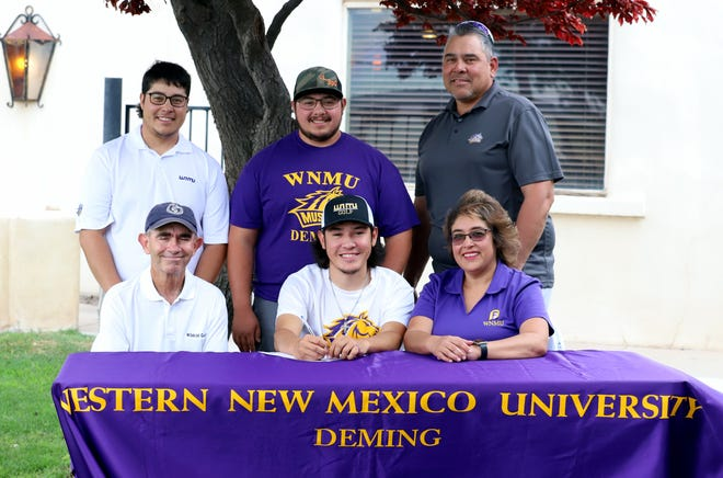 "Aaron ""Nemo"" Perales, seated in center, signed his commitment to the Mustang men's golf program at Western New Mexico University in Silver City. On hand for the signing were, clockwise from top left, brothers Deryk ""Buzz"" Perales, Jordan Perales, father Richard Perales, mother Yvonne Perales and DHS Coach James Williams."