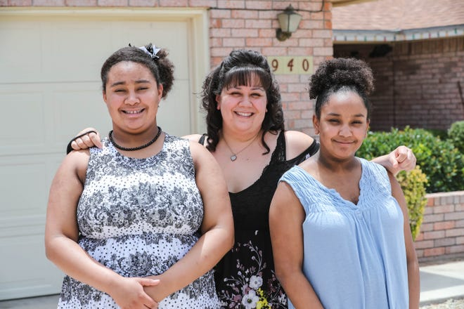 Destiny Richard, Celmari Lopez and Ariya Richard stand in front of their home in Las Cruces on Thursday, July 23, 2020.