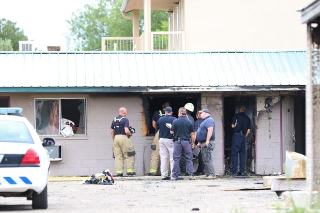 The Farmington Fire Department investigate a blaze at the Sage Motel at the intersection of Glade Lane and Airport Drive on July 23.