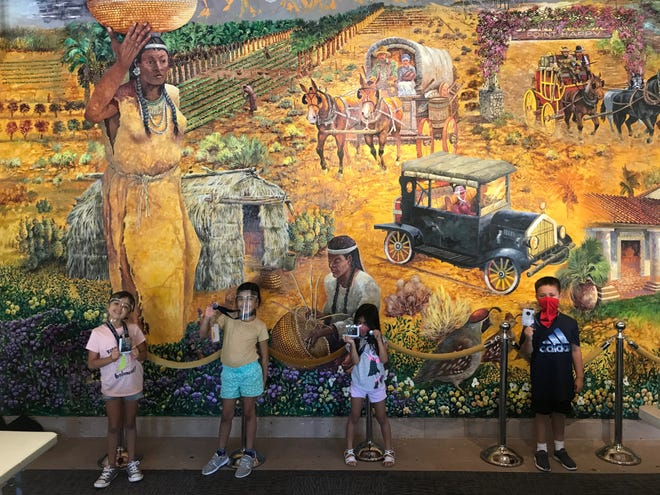 Children at Family YMCA of the Desert daycare at La Quinta Museum have fun while taking precautions for coronavirus.