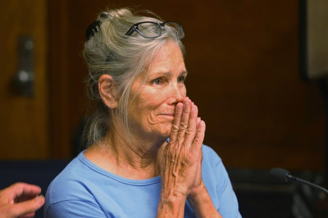 In this Sept. 6, 2017, file photo, Leslie Van Houten reacts after hearing she is eligible for parole during a hearing at the California Institution for Women in Corona, Calif. A California panel has recommended parole for Charles Manson follower Van Houten, who has spent nearly five decades in prison. The recommendation was made Thursday, July 23, 2020, although Gov. Gavin Newsom could decide to deny it.