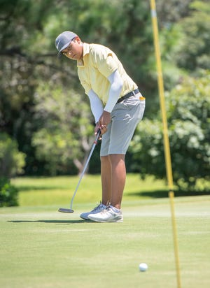 Jaylen Abbas putts during the First Tee of Northwest Florida's Divot Derby at the Tiger Point Golf Club in Gulf Breeze on Wednesday, July 22, 2020.