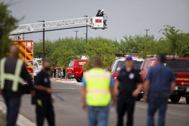 Emergency personnel work to recover the bodies of two construction workers killed at the site of a trench collapse in Phoenix on July 23, 2020.