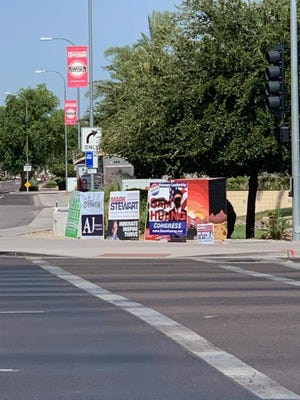 A handful of political signs for Congressional candidate and Chandler City Council member Sam Huang have been vandalized with black spray paint in Chandler.