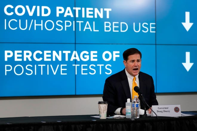 Arizona Republican Gov. Doug Ducey gives the latest Arizona coronavirus update during a news conference on  July 23, 2020, in Phoenix.