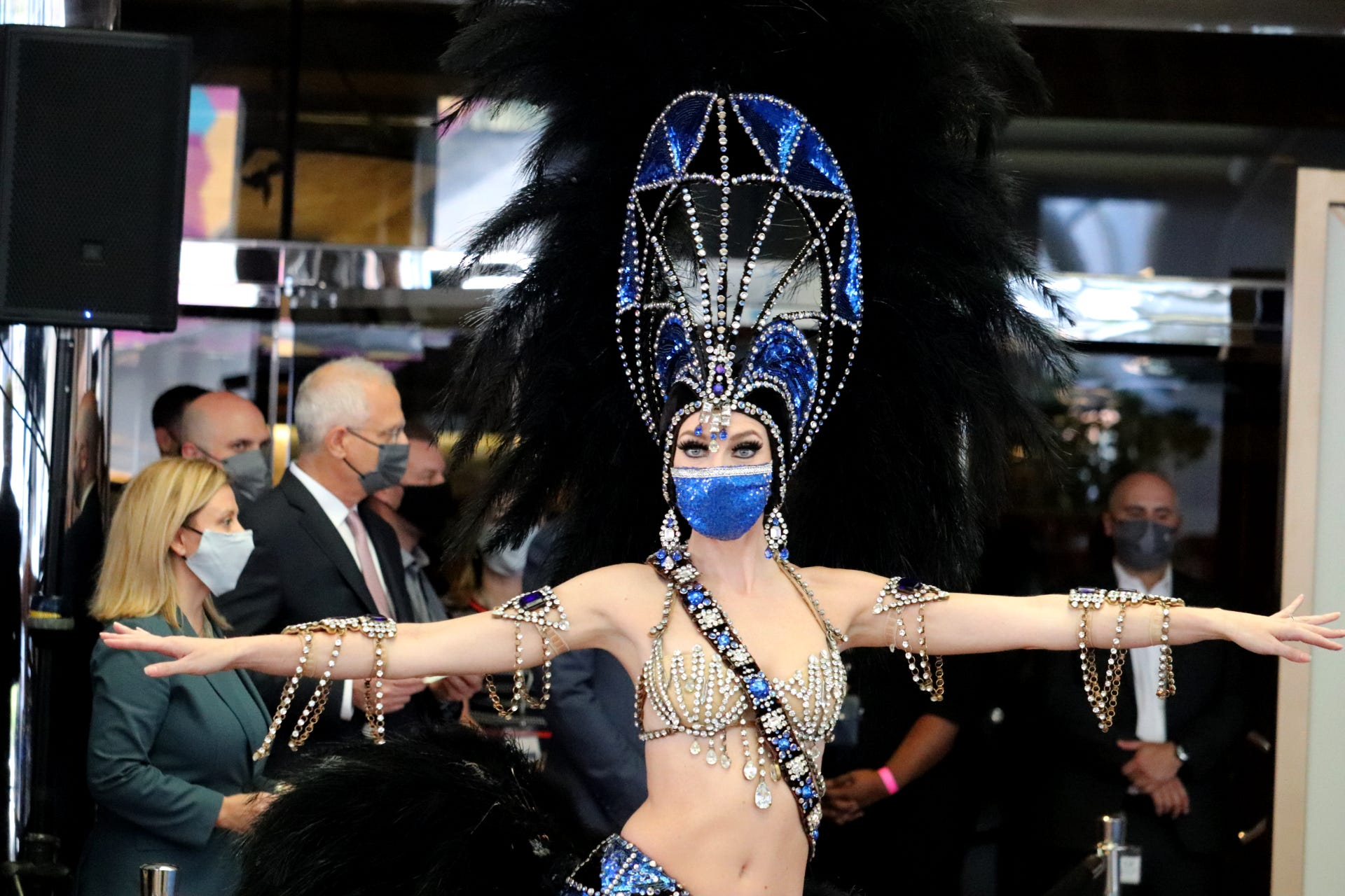 A Las Vegas showgirl welcomes guests to Bally's after a shutdown that lasted more than four months.