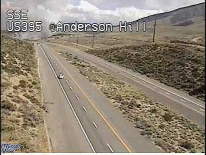 A cloud of smoke is seen over U.S. 395 near Red Rock Road north of Reno.
