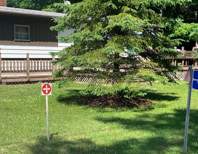 John Ehmann, Town of Wilson chair, said he took this photo of a Ku Klux Klan symbol in James VanEss' yard July 3, 2020. The Sheboygan Press cropped the image to remove the township address sign that was included to confirm the location. The klan is a secretive society organized in the South after the Civil War to assert white supremacy, often using violence. The town board Monday unanimously voted to strip its town constables of their duties after receiving complaints about VanEss.