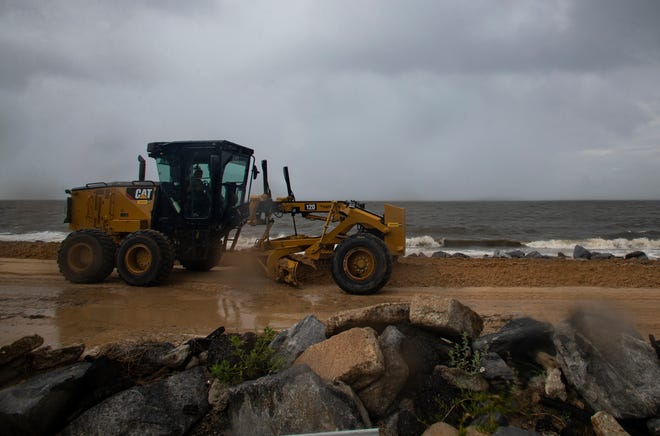 High tides and strong winds wash out Alligator Point Road Wednesday evening, July 22, 2020.