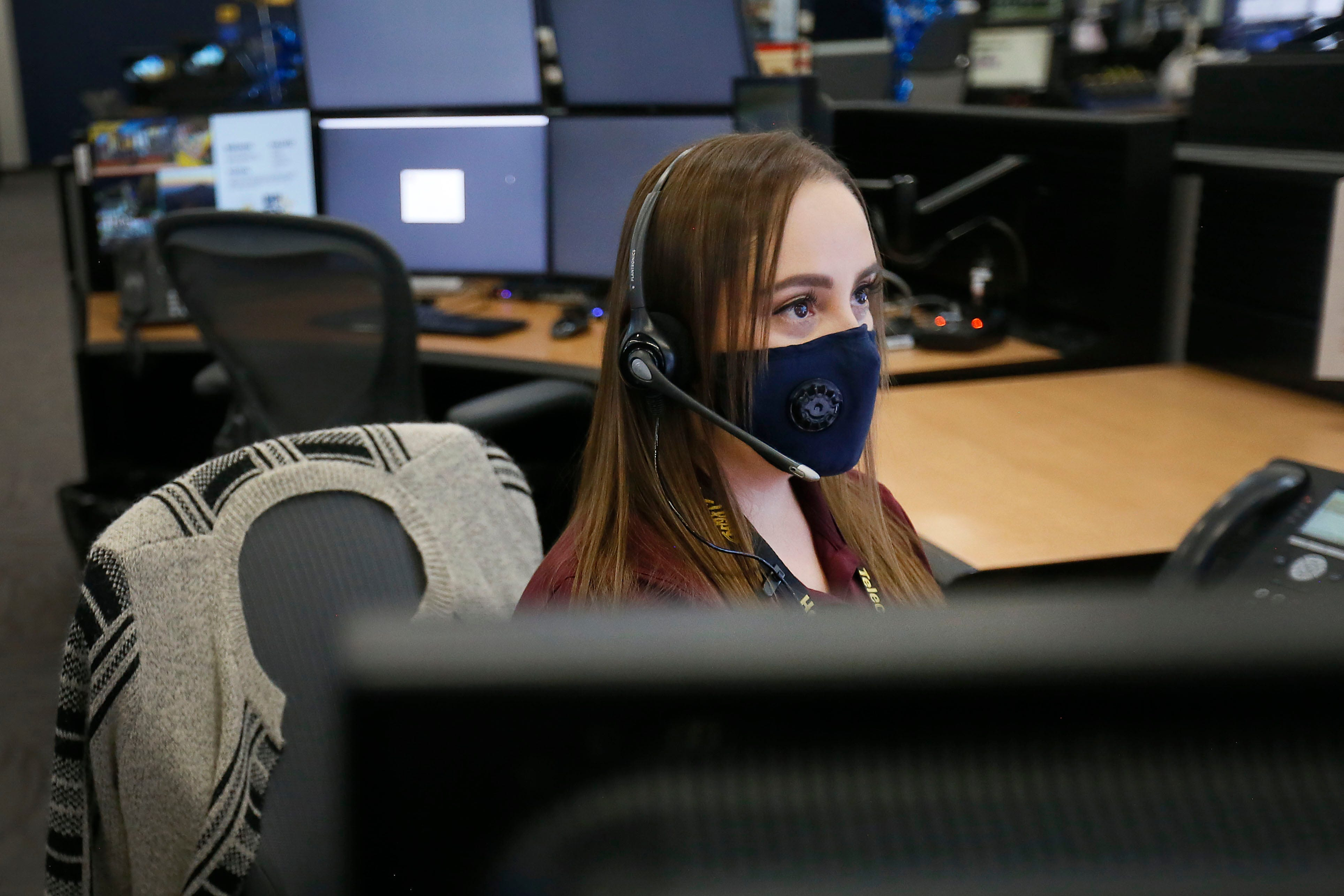 Public safety telecommunicator Bernardette Falcon works Thursday, July 23, at the Regional Communications Center in Northeast El Paso. Falcon was one of the first public safety telecommunicators to take 911 calls from people at Walmart on Aug. 3, 2019.  A woman who stayed on the line with Falcon was able to give a description of the shooter.