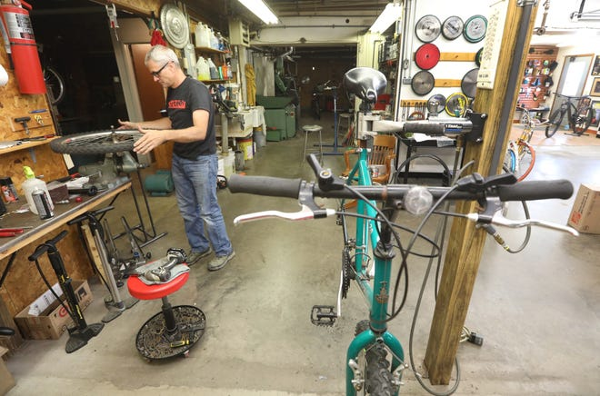 Heath Boedecker, owner of HWB Cycles in Zanesville, works on a bike on Thursday. The nation is facing a bike shortage, and bike repair supplies are starting to be harder come by now too.
