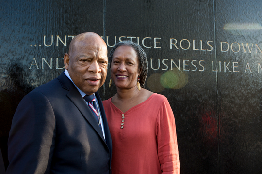 Lecia Brooks, chief of staff of the Alabama-based Southern Poverty Law Center, poses with the late congressman and Civil Rights pioneer, John Lewis.