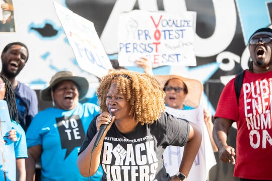 Georgia voting rights activist LaTosha Brown speaks to a group of supporters. Brown is the co-founder of Black Voters Matter, a non-profit aimed at helping Black and other voters of color navigate often complex voting regulations that many activists feel are aimed at suppressing the vote.