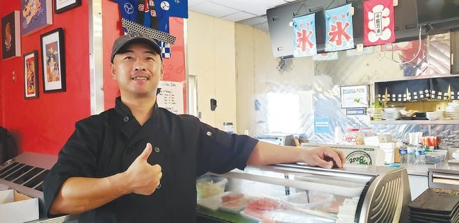"""Tomi Sushi & Steak co-manager Tom Tan gives 'thumb up"""" approval to the Sushi Bar at the new Pratt business which opened July 11 at 1803 East First Street. The location was formerly home to Ninja Sushi Steakhouse.  Another new business in Pratt this year is Los Cabos Fajita House at 1413 East First Street, formerly home to Playa Azul."""