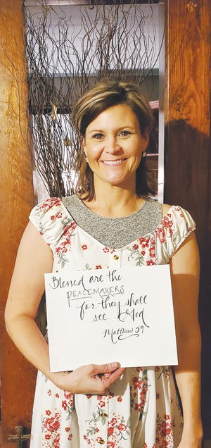 Krystle Dauner of Sawyer enjoys using her writing talents to make gifts for others or provide lettering services for special occassions.