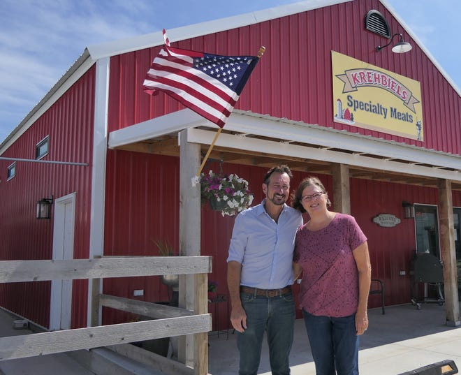 Jeff and Angie Krehbiel outside Krehbiels Specialty Meats in McPherson, Kansas.