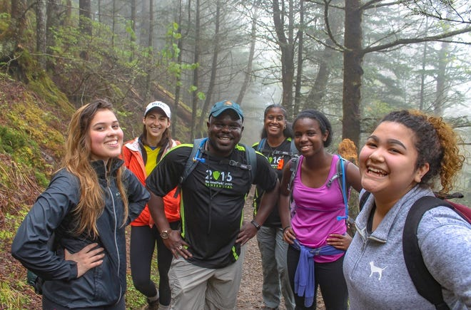 Superintendent Cassius Cash is shown here with participants in the Hike 100 program from 2016. Groups participating in this year's Smokies Hikes for Healing will follow guidance from the Centers for Disease Control and Prevention (CDC) to prevent the spread of COVID-19, including social distancing and wearing of facial coverings when the appropriate distance cannot be maintained.