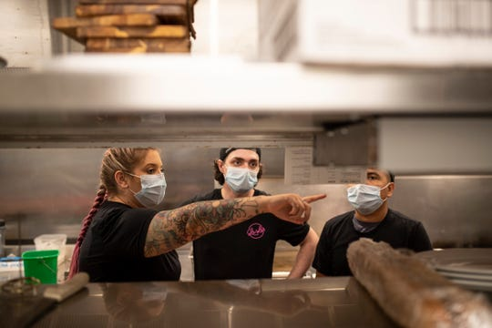 Executive chef Allie Lyttle talks to line cooks Cody Pattenaude and Sam Perez in the kitchen at Lala's in Ann Arbor, Friday, July 24, 2020.