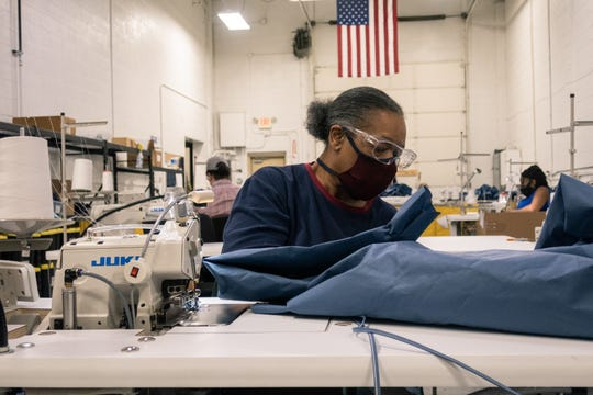 Gettees lead seamstress Jackie George works on sewing a surgical gown in June. The company's sewing staff has doubled to make surgical gowns.