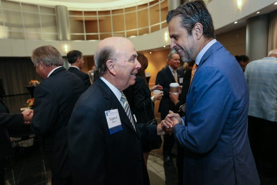 Eugene A. Gargaro Jr., left, talks with Detroit Institute of Arts Director Salvador Salort-Pons, during the 2017 Shining Light Awards breakfast at the Ford Conference and Event Center in Dearborn in October 2017.