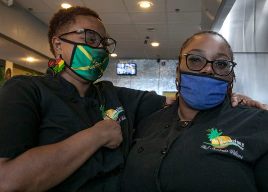 Flavors of Jamaica in Pontiac owner Reniel Billups, 39, left, hired her daughter and pastry chef Shantasia Williams-Billups, 25, to come work with her at her new restaurant and then the pandemic hit forcing them to adjust by doing only curbside carry-out orders in the first few weeks of the pandemic before shutting down completely until they re-opened in June.