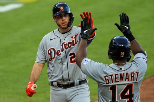 Tigers first baseman C.J. Cron celebrates with left fielder Christin Stewart after hitting a solo home run in the fourth inning of a baseball game against the Cincinnati Reds at Great American Ballpark in Cincinnati, Friday, July 24, 2020.