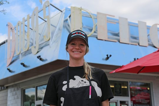 Matt & Mo's co-owner Mo Marzullo poses for a portrait in front of her Chicago-style Italian beef stand operating out of Doug's Delight in Hazel Park on July 24, 2020.