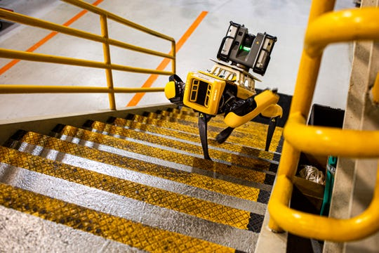 Fluffy looks at Scouter, an Autonomous Mobile Robot that can autonomously navigate facilities while scanning and capturing 3-D point clouds to generate a CAD of the facility.