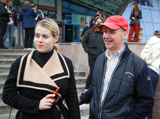 Valery Tsepkalo, a former ambassador to the United States and founder of a successful hi-tech park, smiles as his wife Veronika looks on in Minsk, Belarus, Wednesday, May 26, 2020.