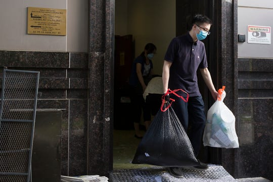 Consulate workers remove items from the Consulate General of China Friday in Houston.  The U.S.government has ordered the Houston consulate to close by Friday.