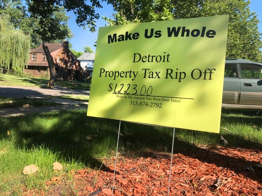 The Detroit activist group Call-'Em Out distributed these lawn signs to homeowners earlier this summer, urging them to write in the amount The Detroit News estimates they were overtaxed by the city between 2010 and 2016.