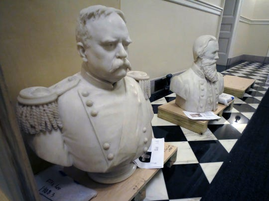 """Busts of Fitzhugh Lee, left, and James E. B """"Jeb"""" Stuart, right sit in a hallway waiting to be boxed after removal from the Old House Chamber inside the Virginia State Capitol in Richmond, Va., Thursday. All busts and plaques relating to the Confederacy were removed, including the statue of Robert E. Lee."""