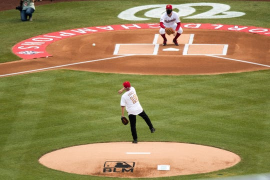 Director of the National Institute of Allergy and Infectious Diseases Dr. Anthony Fauci throws out the ceremonial first pitch at Nationals Park before the New York Yankees and the Washington Nationals play an opening day baseball game, Thursday, July 23, 2020, in Washington.